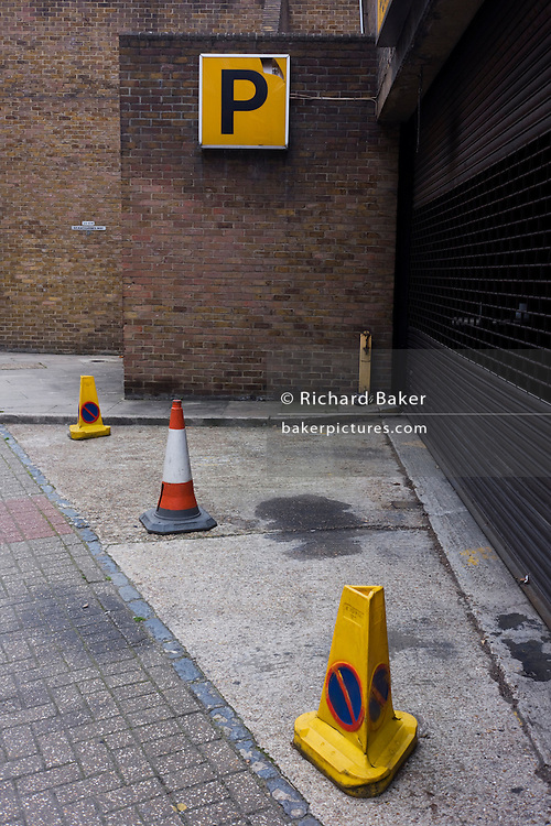 Contradictory closed NCP car park with No Parking cones.