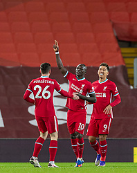 LIVERPOOL, ENGLAND - Sunday, December 27, 2020: Liverpool's Sadio Mané (C) celebrates with team-mates Andy Robertson (L) and Roberto Firmino (R) after scoring the first goal during the FA Premier League match between Liverpool FC and West Bromwich Albion FC at Anfield. The game ended in a 1-1 draw. (Pic by David Rawcliffe/Propaganda)