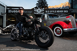 Reini Servello on his 1964 Panhead in front of his Bobber Garage custom motorcycle shop. This shop is the only custom shop in Liechtenstein! (fyi - there are just 38,547 citizens & this country covers just 62 sq mi tucked in between Switzerland and Austria.) The shop is in the the biggest city, Vaduz, at the foot of the mountain and as Reini likes to say, just below where the Boss Man lives (the prince in his castle!)   Monday, February 25, 2019. Photography ©2019 Michael Lichter.