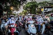 A sea of drivers wait at a red light in Hanoi, Vetnam, Southeast Asia