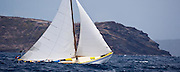 Summer Wind, a Carriacou Sloop, sailing in the Windward Race at the Antigua Classic Yacht Regatta.