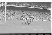 Kerry attempts to get the ball from the hands of the Dublin goalie during the All Ireland Senior Gaelic Football Championship Final Kerry v Dublin at Croke Park on the 22nd September 1985. Kerry 2-12 Dublin 2-08.