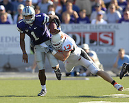 Kansas State quarterback Josh Freeman (1) is tackled from behind by Oklahoma State defensive end Nathan Peterson (13) after picking up a first down in the third quarter, at Bill Snyder Family Stadium in Manhattan, Kansas, October 7, 2006.  The Wildcats beat the Cowboys 31-27.<br />