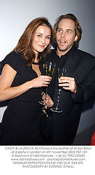 CINDY & LAURENCE BILTON he is the brother of Anton Bilton, at a party in London on 6th November 2002.	PEZ 129