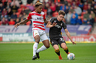 Doncaster Rovers forward Mallik Wilks battles with Bradford city defender Connor Wood during the EFL Sky Bet League 1 match between Doncaster Rovers and Bradford City at the Keepmoat Stadium, Doncaster, England on 22 September 2018.