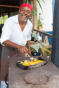 Chef and artist Joao Carlos Silva cooking at his Roca Sao Joao, Sao Tome. The former plantation is now a hotel with a fine restaurant and art gallery. Sao Tome and Principe. Sao Tome and Principe, are two islands of volcanic origin lying off the coast of Africa. Settled by Portuguese convicts in the late 1400s and later a centre for slaving, their independence movement culminated in a peaceful transition to self government from Portugal in 1975.