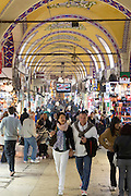 Western tourists shopping in The Grand Bazaar, Kapalicarsi, great market in Beyazi, Istanbul, Republic of Turkey