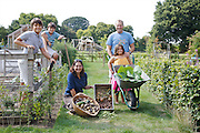 From left to right: Edward, 12, Joseph, 12, Isy, David and Charlotte, 6, in the gardens at Hares Farm CREDIT: Vanessa Berberian for The Wall Street Journal<br /> UKFARM-Hares Farm