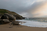 Sunset on an empty beach at Playa Mar de Fora in Finisterre, Spain. Finisterre is the final destination of many pilgrims who walk the Camino de Santiago.