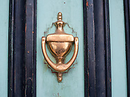 A knocker remains on a colorful door in Virginia City, Nev., on Saturday, April 23, 2011. The Comstock Lode turned Virginia City and surrounding mining communities into boomtowns as people sought their fortunes in gold and silver. The community serves a a living museum to its silver and gold mining past.  (© 2011, Cindi Christie/Cyanpixel® Photography)