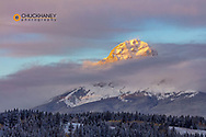 Clouds envelope Crowsnet Mountain at Crowsnest Pass, alberta, Canada