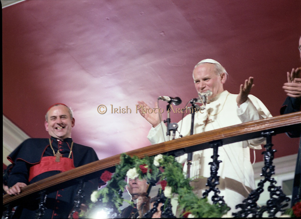 Pope John-Paul II visits Ireland..1979..29.09.1979..09.29.1979..29th September 1979..Today marked the historic arrival of Pope John-Paul II to Ireland. He is here on a three day visit to the country with a packed itinerary. He will celebrate mass today at a specially built altar in the Phoenix Park in Dublin. From Dublin he will travel to Drogheda by cavalcade. On the 30th he will host a youth rally in Galway and on the 1st Oct he will host a mass in Limerick prior to his departure from Shannon Airport to the U.S..Image of Pope John-Paul II and a very happy Cardinal Tomás Ó Fiach acknowledging the crowds.