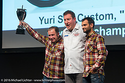 Stefano Martinelli of PDF proudly accepts a trophy for PDF Motociclette's (he and Frenky Davide Francavilla) custom Harley-Davidson JD at the AMD World Championship of Custom Bike Building Award Ceremony on the stage in the custom dedicated Hall 10 at the Intermot Motorcycle Trade Fair. Cologne, Germany. Sunday October 9, 2016. Photography ©2016 Michael Lichter.