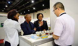 JOHANNESBURG, Oct. 13, 2016 (Xinhua) -- An exhibitor shows Chinese medical products to visitors at the stand of Zhejiang Chinese Medical University during the South?Africa-China Hi-Tech Exhibition in Johannesburg,?South?Africa, on Oct. 13, 2016.?The three-day South Africa-China Hi-Tech Exhibition kicked off on Thursday in Johannesburg with the aim of enhancing relations in the field of science and technology between the two countries.?(Xinhua/Zhai Jianlan) (Credit Image: © Xinhua via ZUMA Wire)