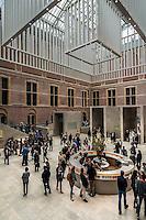 Le Rijksmuseum Amsterdam est un musee national consacre aux beaux-arts, a l'artisanat et a l'histoire du pays. Il est le plus important musée neerlandais en termes de frequentation et d'œuvres d'art avec plus de 2 450 000 visiteurs en 2014 pour un fond d'environ un million de pieces.<br /> Situe entre la Stadhouderskade et la Museumplein (la «Place des Musees»), dans l'arrondissement Amsterdam Oud-Zuid, il presente au public, a travers quelque deux cents salles d'expositions une vaste collection de peintures du siecle d'or neerlandais. <br /> C'est aussi au Rijksmuseum qu'est attache le Rijksprentenkabinet (le «Cabinet national des estampes»). Le musee possede en outre une riche collection d'objets d'art asiatiques.<br /> Le Rijksmuseum a ete fondee a La Haye en 1800 et a demenage à Amsterdam en 1808. Il était situe d'abord dans le palais royal et plus tard dans les Trippenhuis.<br /> Le batiment principal actuel a été conçu par Pierre Cuypers et a ouvert ses portes en 1885.<br /> Le 13 Avril 2013, apres une renovation de dix ans qui a coute 375 millions €, le batiment principal a ete rouvert par la reine Beatrix.<br /> <br /> The Rijksmuseum  (Imperial Museum) is a Dutch national museum dedicated to arts and history in Amsterdam. The museum is located at the Museum Square in the borough Amsterdam South, close to the Van Gogh Museum, the Stedelijk Museum Amsterdam, and the Concertgebouw.<br /> The Rijksmuseum was founded in The Hague in 1800 and moved to Amsterdam in 1808, where it was first located in the Royal Palace and later in the Trippenhuis. The current main building was designed by Pierre Cuypers and first opened its doors in 1885.On 13 April 2013, after a ten-year renovation which cost € 375 million, the main building was reopened by Queen Beatrix In 2013 and 2014, it was the most visited museum in the Netherlands with record numbers of 2.2 million and 2.45 million visitors. Is is also the largest art museum in the country.<br /> The museum has on display 8