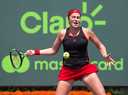 March 28, 2018 - Key Biscayne, Florida, United States - Jelena Ostapenko, from Latvia, in action against Elina Svetolina, from Ukraine, during her quater final match at the Miami Open. Ostapenko defeated Svitolina 7-6(3), 7-6(5) in Miami, on March 28, 2018. (Credit Image: © Manuel Mazzanti/NurPhoto via ZUMA Press)