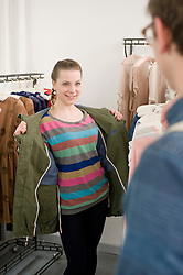 Young couple shopping at fashion store
