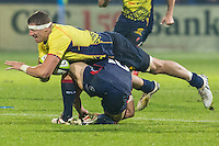 Adam Siddall (C) of USA tries to stop Mihai Macovei (R) of Romania during their  rugby test match between Romania and USA, on National Stadium Arc de Triomphe in Bucharest, November 8, 2014.  Romania lose the match against USA, final score 17-27.