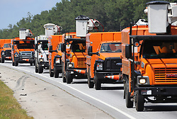 A line of power trucks head south on I-75 toward the Georgia coast in preparation for Hurricane Irma on Friday, September 8, 2017, in Griffin.   (Curtis Compton/Atlanta Journal-Constitution/TNS/Sipa USA)