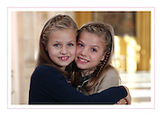 Feliz Navidad! Princesses Leonor, 10, and Sofia, 8, take centre stage as the Spanish royal family release their annual Christmas card <br /> <br /> The Spanish royal family have released their annual Christmas cards, with King Felipe VI and Queen Letizia letting their beautiful young daughters steal the festive limelight.<br /> <br /> Princess Leonor, 10, and Princess Sofia, 8 feature in a warm embrace on the front of the card and even add their own handwritten signatures inside, which is perhaps a subtle reference to the fact that the girls are considered the future of the Spanish monarchy.<br /> <br /> First-in-line-to-the-throne Leonor, who has blue eyes while her sister has brown, throws a protective arm around her sibling for the cute photo. <br /> The smiling royals both wear their blonde hair in a neat side braid and loose at the back. While Leonor has a navy blue cardigan on over her dress, Sofia, 17 months younger, has opted for a cream and green jacket.<br /> <br /> It's a different take on the image the family chose last year, which featured two photographs that were captured in June 2014, shortly after Felipe took the throne from his father Juan Carlos. The images showed both the new King and Queen alone and with their daughters in the second shot.<br /> ©Exclusivepix Media