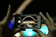 a Fan takes a photo of Wembley Stadium with her camera phone before k/o. UEFA Champions league match, group E, Tottenham Hotspur v CSKA Moscow at Wembley Stadium in London on Wednesday 7th December 2016.<br /> pic by John Patrick Fletcher, Andrew Orchard sports photography.