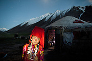 Chinor, a young Kyrgyz girl, lit by her brother's flashlight..Daily life at the Khan (chief) summer camp of Kara Jylga...Trekking through the high altitude plateau of the Little Pamir mountains (average 4200 meters) , where the Afghan Kyrgyz community live all year, on the borders of China, Tajikistan and Pakistan.