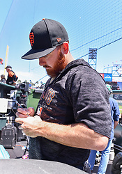 April 29, 2018 - San Francisco, CA, U.S. - SAN FRANCISCO, CA - APRIL 29: San Francisco Giants Pitcher Sam Dyson (49) autographing a ball prior to the San Francisco Giants and Los Angeles Dodgers game at AT&T Park on April 29, 2018 in San Francisco, CA.  (Photo by Stephen Hopson/Icon Sportswire) (Credit Image: © Stephen Hopson/Icon SMI via ZUMA Press)