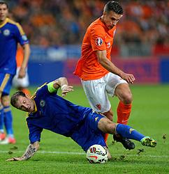 10-10-2014 NED: UEFA EK Kwalificatie Nederland - Kazachstan<br /> Robin van Persie wordt door Renat Abdulin binnen de 16 onderuit gehaald, penalty