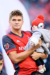 October 28, 2018 - Toronto, ON, U.S. - TORONTO, ON - OCTOBER 28: Nick Hagglund (6) of Toronto FC stands for the national anthems with his daughter before the MLS Decision Day match between Toronto FC and Atlanta United FC on October 28, 2018, at BMO Field in Toronto, ON, Canada. (Photograph by Julian Avram/Icon Sportswire) (Credit Image: © Julian Avram/Icon SMI via ZUMA Press)
