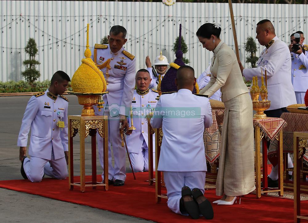 May 2, 2019 - Bangkok, Thailand - Thailand's King Maha Vajiralongkorn Bodindradebayavarangkun (L) and Queen Suthida (R) pay homage to the statue of former King Chulalongkorn or King Rama V ahead of the royal coronation at the Royal Plaza in Bangkok. (Credit Image: © Pool/SOPA Images via ZUMA Wire)