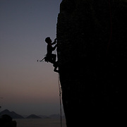Rock Climbers practice on the many rocks and boulders around the popular tourist attraction Sugar Loaf Mountain. Rio de Janeiro,  Brazil. 26th August 2010. Photo Tim Clayton.