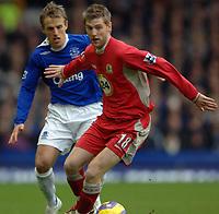Photo: Paul Greenwood.<br />Everton v Blackburn Rovers. The Barclays Premiership. 10/02/2007. Blackburn's David Bentley, right, holds off Everton's Phil Neville