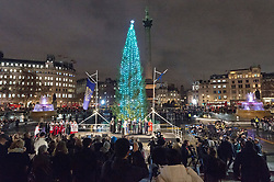 © Licensed to London News Pictures. 06/12/2018. London, UK. Visitors view the Trafalgar Square Christmas tree lighting. Every year, since 1947, the people of Norway have given the people of London a Christmas tree. This gift is in gratitude for Britain's support for Norway during World War II. Photo credit: Ray Tang/LNP