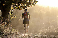 Christiaan Greyling runs into the rising sun during Stage 1 of the Tankwa Trail on Friday the 17th of February 2017. Photo by: Oakpics / Dryland Event Management / SPORTZPICS {dem16gst}