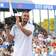 NICK KYRGIOS holds the Citi Open trophy aloft after winning the 2019 Citi Open championship.