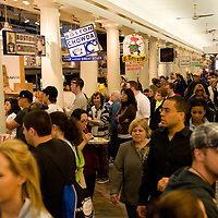 By the early 1970s, Boston's meat and produce had moved to larger, more modern facilities and Quincy Market was decaying. Using a combination of public and private financing, the architectural firm Benjamin Thompson and Associates and the developer Rouse Company developed a new building form, the festival marketplace. The new Faneuil Hall Marketplace, incorporating Quincy Market, opened in 1976. In 1977, it received the Harleston Parker Medal and in 2009, the AIA's Twenty-five Year Award..The main Quincy Market building continues to be a source of food for Bostonians, though it has changed from grocery to food-stall, fast-food, and restaurants. It is a popular and busy lunchtime spot for downtown workers. In the center, surrounding the dome, is a two-story seating area..Further street vending space is available against the outside walls of the building, especially on the south side, under a glass enclosure. Most stalls in this space sell trinkets, gifts, and other curiosities. A few restaurants also occupy fully enclosed spaces at the ends of this enclosure..More conventional retail space is provided on the second floor and in the basement level. The Comedy Connection, one of Boston's two largest comedy clubs, only recently vacated one of the second-floor spaces, and bars and restaurants occupy space on the basement levels..Flanking the main building in the marketplace are two equally long buildings (North Market and South Market) that expand the market space for more restaurants, specialty shops, and office spaces. Two further concave market buildings enclose a circular plaza at the market's west end..The open spaces at both the east and west ends of the marketplace are a common venue for various street performers, as well as street vendors. Most daytime visits to Quincy Market will encounter a large circular crowd of people standing around a juggler or other act. wikipedia
