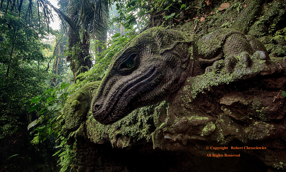 Dragons of the Morning: Dawn and these detailed concrete Komodo Dragons lord down upon a tropical river valley, in the Monkey Forest Park, Ubud Bali Indonesia.