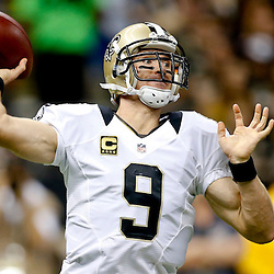 Sep 22, 2013; New Orleans, LA, USA; New Orleans Saints quarterback Drew Brees (9) against the Arizona Cardinals during the first half of a game at Mercedes-Benz Superdome. The Saints defeated the Cardinals 31-7. Mandatory Credit: Derick E. Hingle-USA TODAY Sports