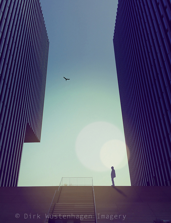 surreal urban scene - person standing between two modern buildings<br /> <br /> Prints and more:http://society6.com/product/urban-light-play-cgd_print#1=45
