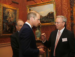The Duke of Cambridge speaks to Erik Schmidt, Executive Chairman of Alphabet, as he attends a reception at Buckingham Palace in London marking the 50th anniversary of the Kennedy Memorial Trust, a scholarship programme set up in memory of John F Kennedy.