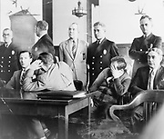 Mafia trial USA.. Louis 'Lepke' Buchalter, facing front, seated with Emanuel 'Mendy' Weiss and Phillip 'Little Farvel' Cohen who shield their faces, and Louis Capone, in a Kings County Courtroom during jury selection 1941