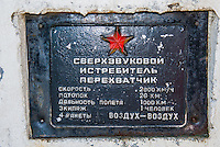 Russia, Sakhalin, Yuzhno-Sakhalinsk. An exhibition of old-style Soviet era military vehicles and planes. A plaque for a MIG fighter.