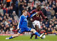 Photo: Daniel Hambury.<br />Arsenal v Cardiff City. The FA Cup. 07/01/2006.<br />Arsenal's Quincy Owusu-Abeyie (R) and Cardiff's Rhys Weston battle for the ball.