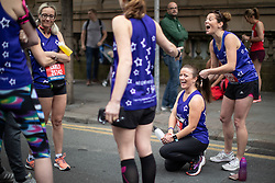 © Licensed to London News Pictures . 19/05/2019. Manchester, UK. Woman running for Mummy's Star , which supports women with cancer during pregnancy , prepare ahead of the race . The Great Manchester Run takes place in Manchester City Centre , starting at Portland Street . Photo credit : Joel Goodman/LNP