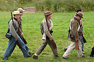 Montgomery, N.Y. - Confederate soldiers march in formation during a Civil War reenactment at the Orange County Farmers Museum on Sept. 23, 2006. The reenactment was hosted by the 124th New York State Volunteers, also known as the Orange Blossoms.