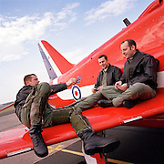 Pilots from the 'Red Arrows', Britain's Royal Air Force aerobatic team, play Top Trumps on the wing of a Hawk jet.