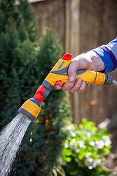 Hand gun and sprinkler hose attachment