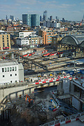 Elevated views overlooking Kings Cross Station with the city on the horizon and a construction site in the foreground on the 10th April 2019 in London in the United Kingdom.