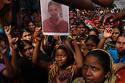 Apparel workers of Esco garment  stage demonstration holding their fellow colleague Salma's photo at Shawrapara M. Salma was ill and died while she working mandatory overtime.  15th January 2008. Mirpur. Dhaka, Bangladesh. .