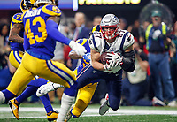 New England Patriots' Rob Gronkowski (87) catches a pass in front of Los Angeles Rams' Marcus Peters (22) and Cory Littleton (58) during the second half of the NFL Super Bowl 53 football game Sunday, Feb. 3, 2019, in Atlanta.<br /> (Tom DiPace via AP)